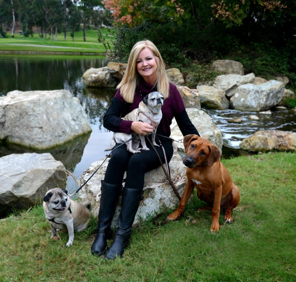 Carrie with dogs at Divine Canine Pet Sitting